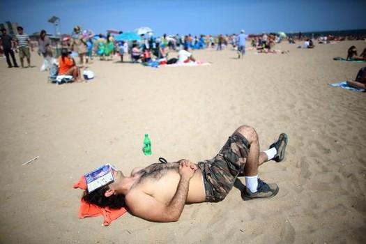 sleeps on the beach